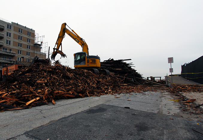Processing debris at Long Beach, NY Boardwalk, 2013